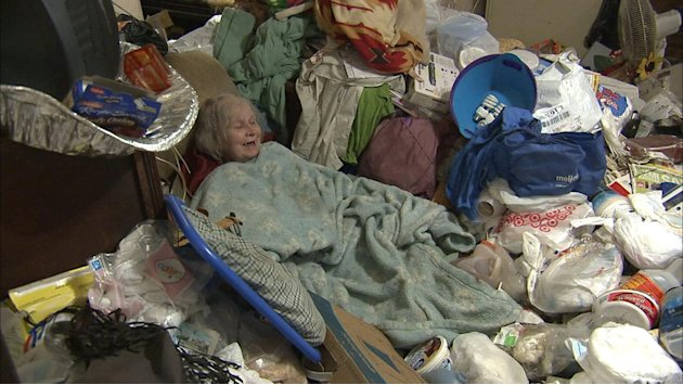"Janet camouflaged and surrounded by hoard in season premiere of ""Hoarders."""