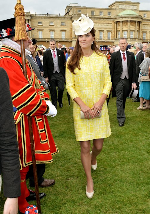 Kate teamed her bright yellow coat with nude accessories [Getty]