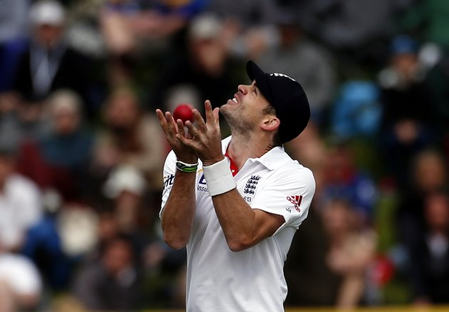 England's Anderson takes a catch to dismiss New Zealand's captain McCullum for 74 runs during the fourth day of the first test at the University Oval in Dunedin