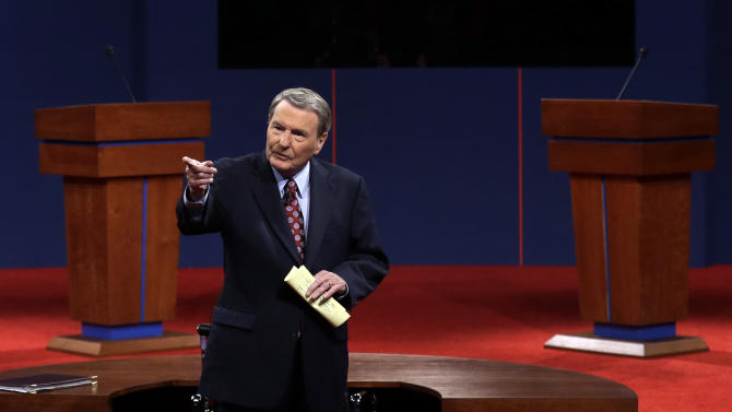 Moderator Jim Lehrer  addresses the audience before the first presidential debate at the University of Denver, Wednesday, Oct. 3, 2012, in Denver. (AP Photo/Charlie Neibergall)