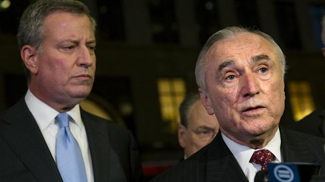 FILE - In this Dec. 9, 2014 file photo, New York City Police Commissioner William Bratton, right, along with New York City Mayor Bill de Blasio, hold a news conference in New York.  Even as New York's police department takes heat for its tactics in the outrage over the Eric Garner chokehold case, year-end crime statistics show two clear trends: low-level arrests are holding steady and overall crime continues to fall.  (AP Photo/Craig Ruttle)