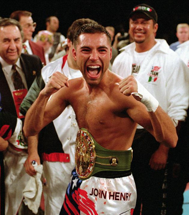 In this June 7, 1996 file photo, newly crowned WBC super lightweight champion Oscar De La Hoya poses with the belt he won from Julio Cesar Chavez by TKO in the fourth round in Las Vegas. De La Hoya, F