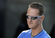 German Mercedes driver Michael Schumacher arrives for the German Formula One Grand Prix in Hockenheim, Germany, Sunday, July 22, 2012. (AP Photo/dapd, Sascha Schuermann)