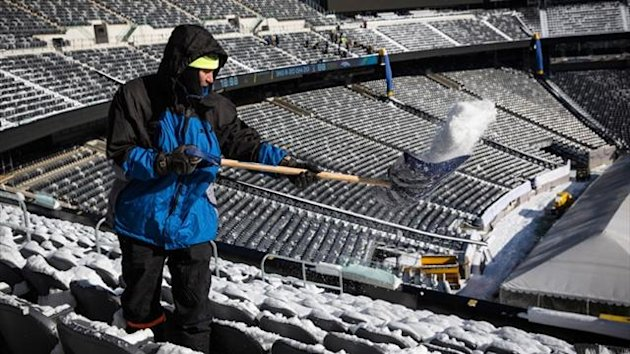 A crew member works to remove snow from MetLife Stadium, which will host the Superbowl (AFP)