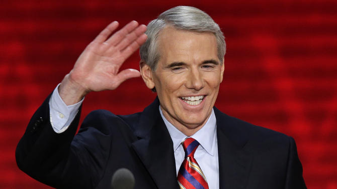 FILE - In this Aug. 29, 2012 file photo, Ohio Senator Rob Portman waves to the delegates during the Republican National Convention in Tampa, Fla. Portman said Thursday, March 14, 2013 that he now supports gay marriage and says his reversal on the issue began when he learned one of his sons is gay. (AP Photo/J. Scott Applewhite, File)