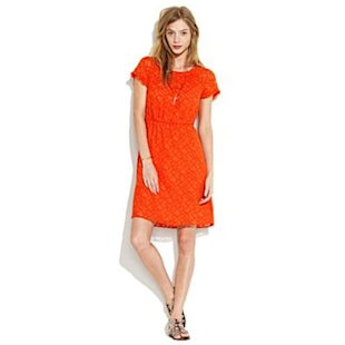 Stitch and bait. Reel in lookers in this shocking chic orange dress.