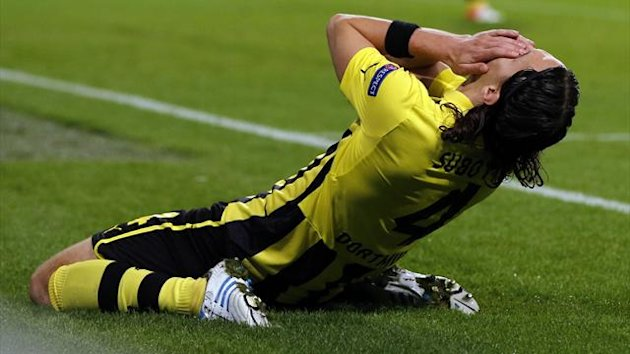 Borussia Dortmund's Neven Subotic reacts after was penalised for handball (Reuters)