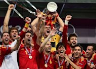 Spanish players celebrate with the trophy after winning the Euro 2012 football championships final match Spain vs Italy at the Olympic Stadium in Kiev. Spain confirmed their status as one of the greatest national teams in football history by overwhelming Italy 4-0 in Sunday&#39;s Euro 2012 final in Kiev to retain their European crown