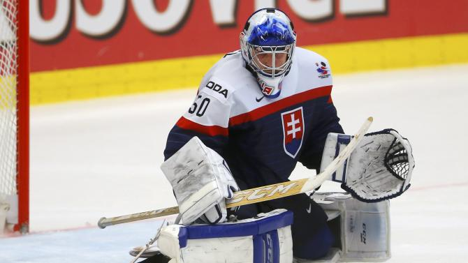 Slovakia's goaltender Laco defends during their Ice Hockey World Championship game against Slovenia at the CEZ arena in Ostrava