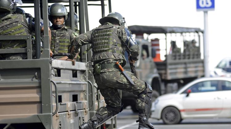 Soldiers are deployed in the city center to prevent looting during a police strike in Salvador