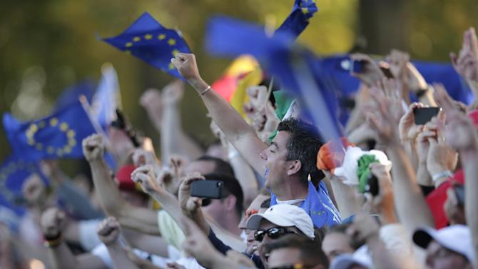 European fan celebrate their comeback win at the Ryder Cup PGA golf tournament Sunday, Sept. 30, 2012, at the Medinah Country Club in Medinah, Ill. (AP Photo/Charlie Riedel)