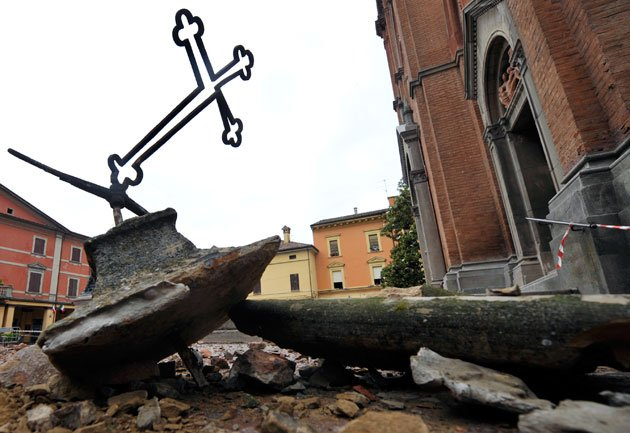 The toppled cross of a church lies amid debris in Crevalcore, northern Italy, Sunday, May 20. 2012. A magnitude-6 earthquake shook northern Italy early Sunday at 4:04 a.m. between Modena and Mantova,