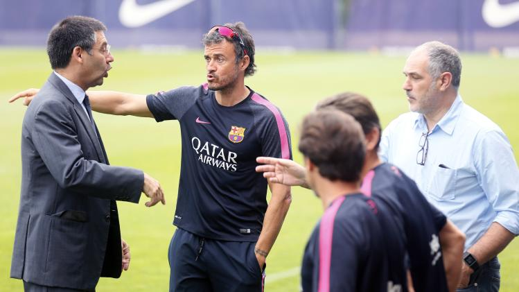 FC Barcelona president Bartomeu, coach Enrique and Sports Director Zubizarreta speak during a training session at Joan Gamper training camp, near Barcelona