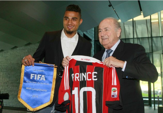 Player Boateng of Italian soccer club AC Milan receives a pennon as he presents a jersey to FIFA President Blatter before a meeting in Zurich