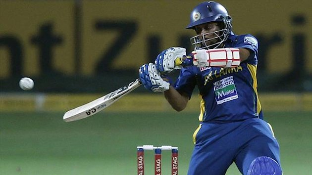 Sri Lanka's Tillakaratne Dilshan plays a shot during their third One Day International (ODI) cricket match against New Zealand in Pallekele