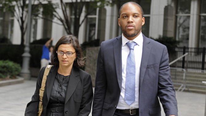 Federal defense attorneys Sabrina Shroff and Jerrod Thompson Hicks exit Manhattan federal court, Saturday, Oct. 6, 2012, in New York. Abu Hamza al-Masri, entered no plea to charges of conspiring with Seattle men to set up a terrorist training camp in Oregon and of helping abduct 16 hostages, two of them American tourists, in Yemen in 1998.  (AP Photo/ Louis Lanzano)