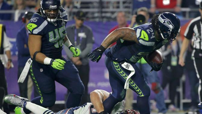 New England Patriots defensive end Ninkovich is unable to bring down Seattle Seahawks running back Lynch in the third quarter during the NFL Super Bowl XLIX football game in Glendale