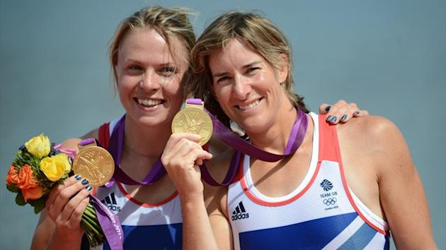 Great Britain's Anna Watkins (L) and Katherine Grainger pose on the podium after receiving their gold medals (AFP)