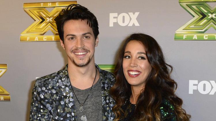 Folk duo Kinsey and Deaton pose backstage after winning for X Factor in Los Angeles