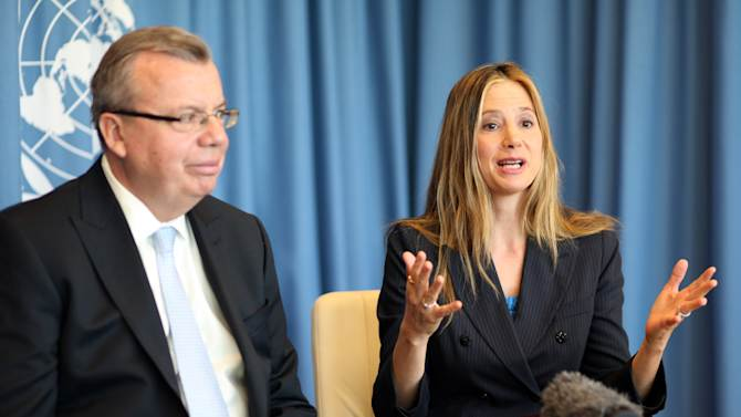 """UNODC's Executive Director Yury Fedotv, left, and US actress Mira Sorvino, a UN Goodwill Ambassador to combat human trafficking for the United Nations Office on Drugs and Crime, UNODC, attend an interview by the Associated Press at the United Nations in Vienna, Austria, Friday, Feb. 8, 2013. """"I love acting and that is my job right now,"""" Sorvino says. At the same time, she describes her advocacy against human trafficking and modern-day slavery as """"my calling,"""" and so important that """"in a decade or so, I wouldn't mind just switching to a career in humanitarian causes."""" (AP Photo/Alexander Mueller)"""