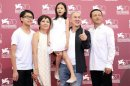 "Actors Yi-Cheng, Yi-ching, Yi-chieh, director Ming-Liang and actor Kang-sheng pose during a photocall for the movie ""Stray Dogs"" in Venice"