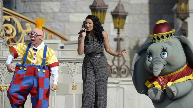 Singer Jordin Sparks, center, performs during the grand opening ceremony for the New Fantasyland attraction at the Walt Disney World Resort's Magic Kingdom theme park in Lake Buena Vista, Fla., Thursday, Dec. 6, 2012. The new attraction is the largest expansion at the Magic Kingdom.(AP Photo/Phelan M. Ebenhack)
