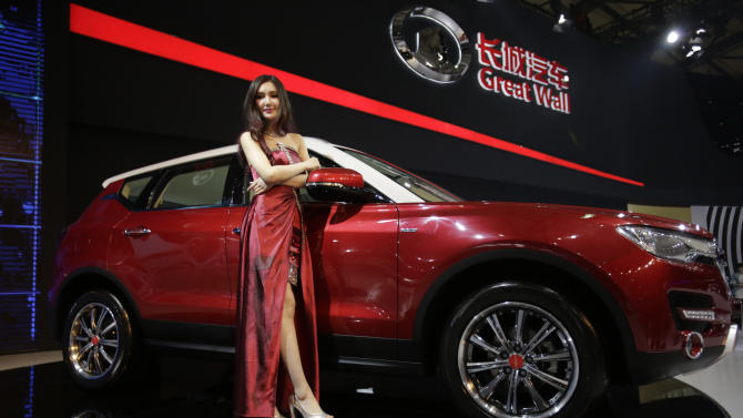FILE - In this Saturday, April 20, 2013 file photo, a model poses with a Great Wall H7 SUV at the Shanghai International Automobile Industry Exhibition (AUTO Shanghai) media day in Shanghai, China. SUV sales in China rose 20 percent last year to 2.5 million vehicles, more than double the 8 percent growth of the overall auto market, according to LMC Automotive. SUVs made up 18 percent of all vehicles sold.  Great Wall Motor Co., has become the Chinese industry's breakout success on the strength of its SUVs. The company, headquartered in Baoding, an industrial city southwest of Beijing, said SUV sales in the first three months of the year rose 95 percent over a year earlier and accounted for half the 180,000 vehicles it sold. (AP Photo/Eugene Hoshiko, File)