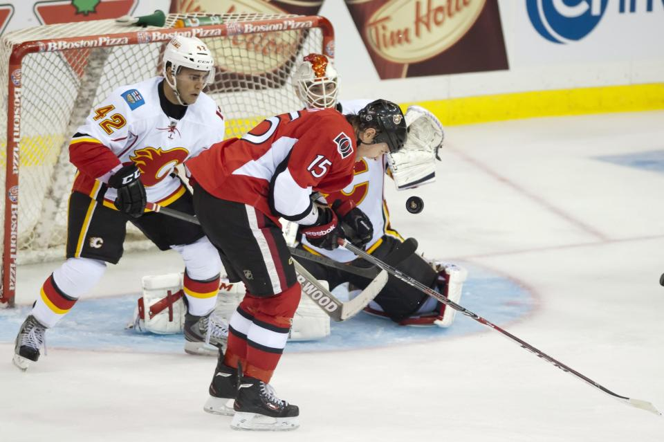 Robinson scores another as Senators top Flames