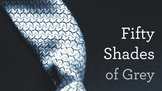 """This book cover image provided by Vintage Books shows """"Fifty Shades of Grey,"""" by E L James. They're young and old, doctors and churchgoers, gay and straight _ and those are just the MEN who have devoured oh-so-naughty """"Fifty Shades of Grey,"""" a violent, erotic trilogy that has earned millions of women fans in a matter of weeks. (AP Photo/Vintage Books)"""