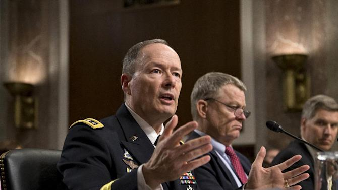 Gen. Keith B. Alexander, director of the National Security Agency and head of the U.S. Cyber Command, answers questions from lawmakers on Capitol Hill in Washington, Wednesday, June 12, 2013, during a Senate Appropriations Committee hearing. It is his first public appearance before Congress since revelations that the electronic surveillance agency is sweeping up Americans' phone and Internet records in its quest to investigate terrorist threats. Left to right are Gen. Keith B. Alexander, director of the National Security Agency, Rand Beers, under secretary for the Department of Homeland Security, and Patrick Gallagher, director of the Commerce Department's National Institute of Standards and Technology. (AP Photo/J. Scott Applewhite)