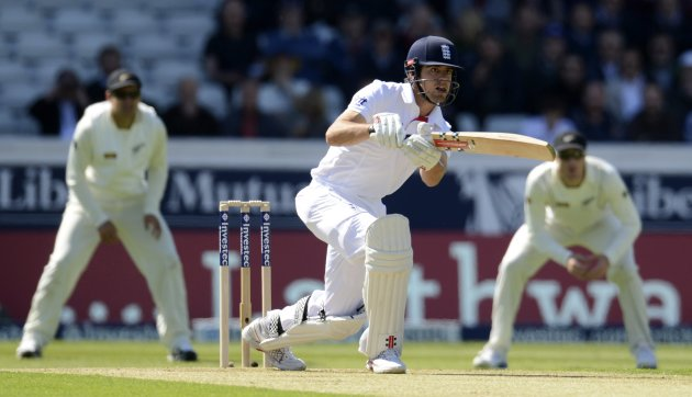 England's Cook plays a shot as New Zealand's Taylor and Guptill watch during the second test cricket match in Leeds