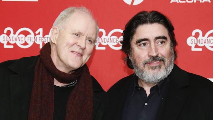 "File-This Jan. 18, 2014, file photo shows cast members John Lithgow, left, and Alfred Molina, right, posing at the premiere of the film ""Love is Strange"" during the 2014 Sundance Film Festival in Park City, Utah. (Photo by Danny Moloshok/Invision/AP)"