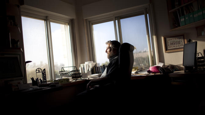 In this photo taken Tuesday, June 28, 2011, computer science professor Moshe Koppel of Bar Ilan University poses for a portrait at his desk in the Jewish settlement of Efrata, near the West Bank town of Bethlehem. Software developed by an Israeli team of scholars led by Moshe Koppel, of Bar Ilan University near Tel Aviv, is giving intriguing new hints about what researchers believe to be the multiple hands that wrote the Bible. (AP Photo/Bernat Armangue)
