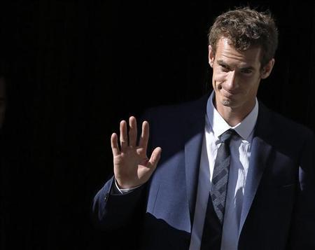 Wimbledon men's singles champion Andy Murray of Britain waves as he departs Number 10 Downing Street in London