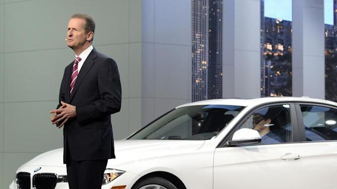 Dr. Herbert Diess, of the BMW Board of Management, speaks next to a 320i model at the North American International Auto Show in Detroit