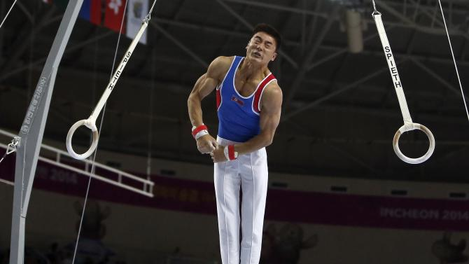 North Korea's Han Jonghyok competes in the rings event for the men's individual all-around final gymnastics competition at the Namdong Gymnasium Club during the 17th Asian Games in Incheon