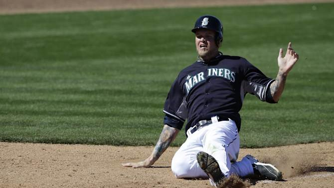 Seattle Mariners' Corey Hart slides during an exhibition spring training baseball game against the Texas Rangers Sunday, March 9, 2014, in Peoria, Ariz. (AP Photo/Darron Cummings)