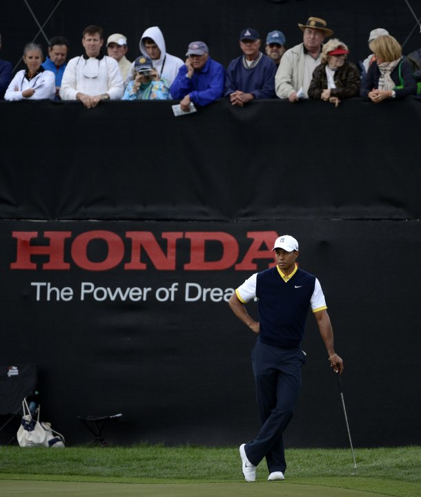 Fans watch Tiger Woods of the U.S. as he waits to putt at the 9th hole during second round play in the Honda Classic PGA golf tournament in Palm Beach Gardens