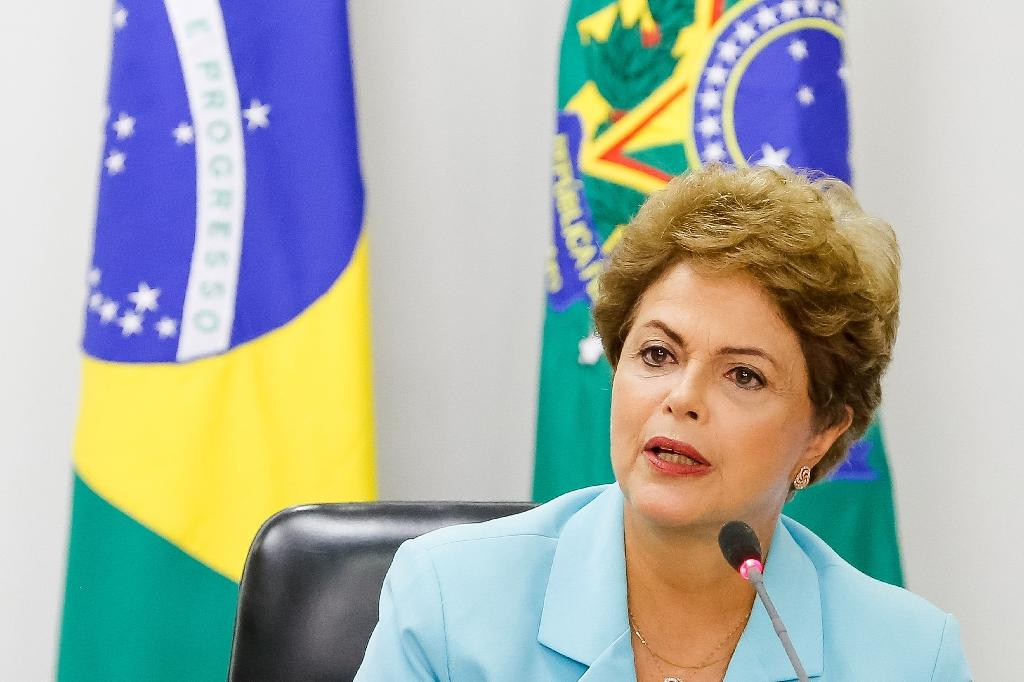 Embattled Rousseff pledges support for Brazil workers