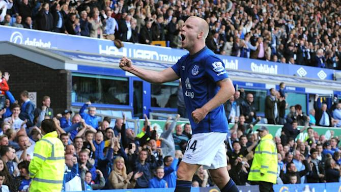 Everton's Steven Naismith celebrates after scoring against Arsenal during the English Premier League soccer match between Everton and Arsenal at Goodison Park, in Liverpool, England, Saturday, Aug. 23, 2014. (AP Photo/Rui Vieira)