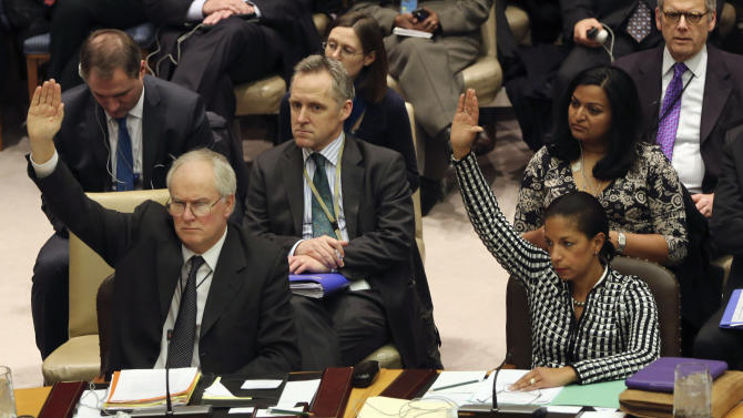 British Ambassador to the United Nations Mark Lyall Grant, left, and American Ambassador Susan Rice vote on a Security Council resolution condemning North Korea's rocket launch in December that sent a satellite into orbit, Tuesday, Jan. 22, 2013 at United Nations headquarters.  (AP Photo/Mary Altaffer)