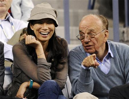File photo of Newscorp CEO Murdoch sitting with his wife Wendi during a match at the U.S. Open tennis championship in New York