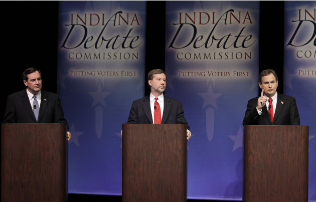 Candidate for Indiana's U.S. Senate seat Republican Richard Mourdock, right, pivots the discussion towards the Affordable Healthcare Act after answering a question on abortion, as fellow candidates De