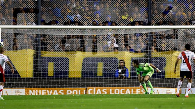 River Plate's goalkeeper Barobero and teammates watch as the ball hits the goal post during their Argentine First Division soccer match against Boca Juniors in Buenos Aires