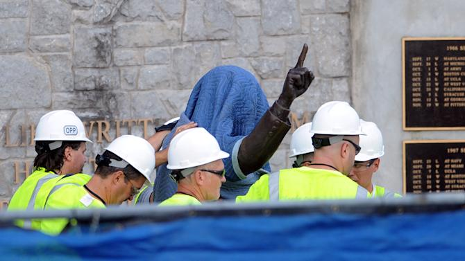 Penn State Office of Physical Plant workers cover the statue of former football coach Joe Paterno near Beaver Stadium on Penn State's campus in State College, Pa., on Sunday, July 22, 2012. The university announced earlier Sunday that it was taking down the monument in the wake of an investigative report that found the late coach and three other top Penn State administrators concealed sex abuse claims against retired assistant coach Jerry Sandusky. (AP Photo/Centre Daily Times, Christopher Weddle) MANDATORY CREDIT; MAGS OUT