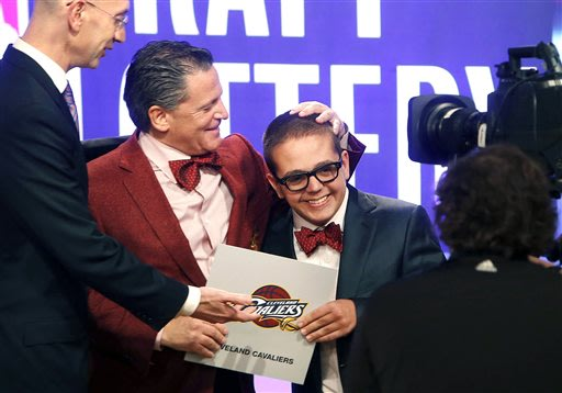 Cleveland Cavaliers owner Dan Gilbert congratulates his son Nick Gilbert after the team won the NBA basketball draft lottery, Tuesday, May 21, 2013 in New York