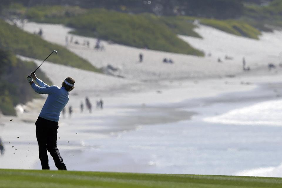 Brandt Snedeker follows his shot on the ninth fairway of the Pebble Beach Golf Course during the final round of the AT&T Pebble Beach Pro-Am golf tournament, Sunday, Feb. 10, 2013, in Pebble Beach, Calif. (AP Photo/Ben Margot)