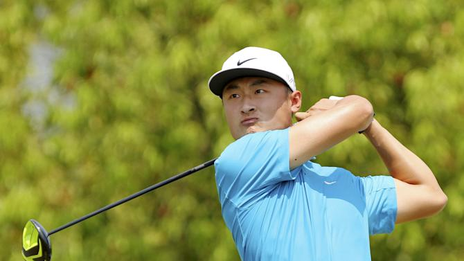 Li of China tees off on the second hole during the third day of the China Open at Tomson Golf Club in Pudong, Shanghai