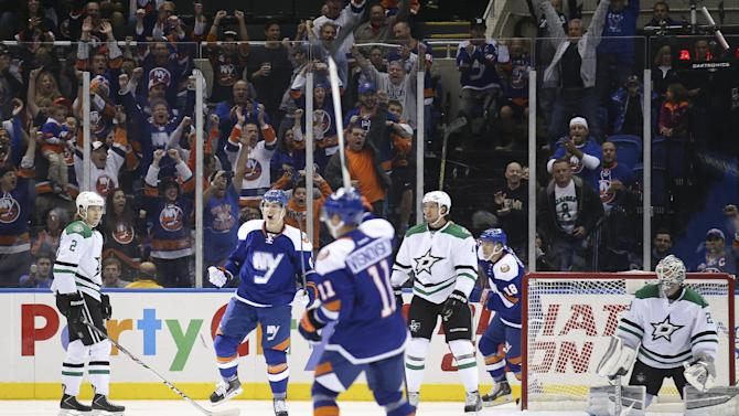 New York Islanders center Anders Lee, second from left, reacts after scoring on Dallas Stars goalie Anders Lindback, of Sweden, right, during the first period of an NHL hockey game, Saturday, Oct. 25, 2014, in Uniondale, N.Y. (AP Photo/John Minchillo)