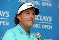 "In this photo provided by World Sport Group Phil Mickelson of the US speaks during a press conference ahead of the Barclays Singapore Open at the Sentosa Golf Club in Singapore. Mickelson said banning long putters would be ""grossly unfair"", disagreeing with long-time rival Tiger Woods and adding to the uproar as golf chiefs consider the move"
